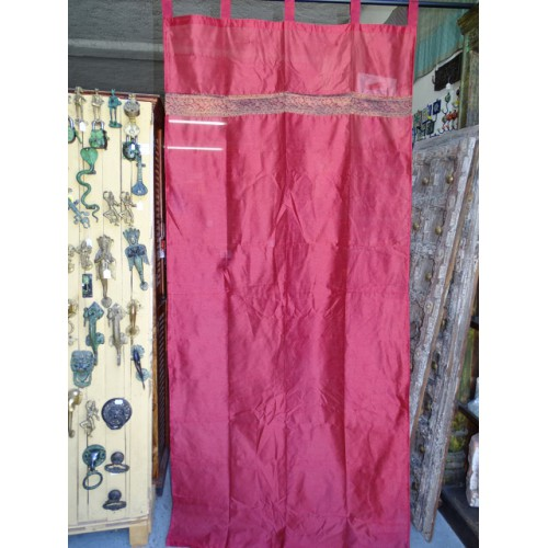 Burgundy taffeta curtains with a brocade band